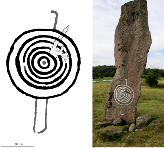 Stele A, south side. The previously known concentric circles representing the sun and/or a shield have now been found to have two legs and a head, that is, we are looking at a person holding a shield and/or the sun.