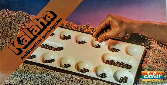 This mancala game from c. 1980 was marketed as a game from ancient Egypt. Therefore the art director painted some guy's arm brown and photographed the game in a pile of sand.