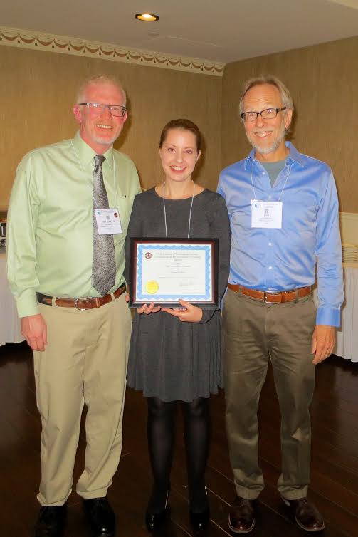 Casey Mueller (middle) receiving the New Investigator Award. She is receiving the award from the Comparative and Evolutionary Physiology section Chair, Dr. Michael Hedrick (left) and this year's Krogh Awardee Dr. Jon Harrison (right)