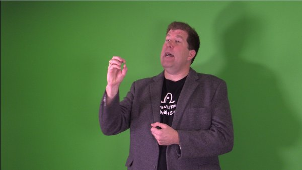 Me in front of a green screen making a dramatic gesture.
