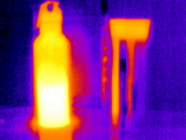 Thermal image of my metal water bottle (left) and my insulated coffee mug, both half-full with hot water. Taken with a Seek Thermal camera on my Android phone.