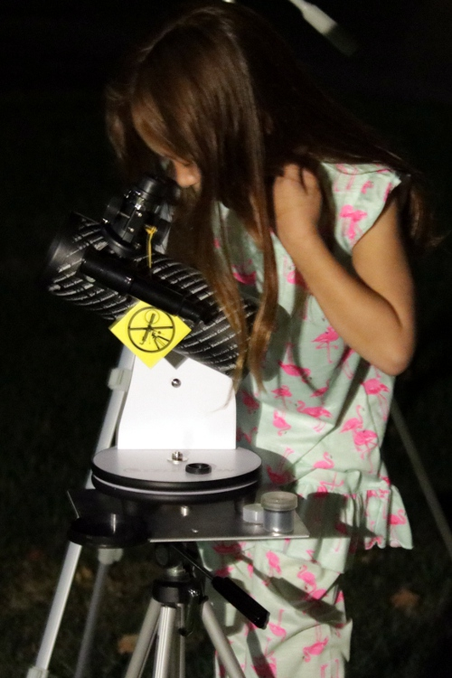SteelyKid looking at the eclipse through her telescope.