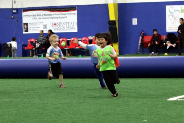 The Pip playing superhero tag at SoccerTots.