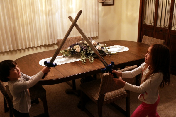 SteelyKid and The Pip in their traditional Nerf sword battle.