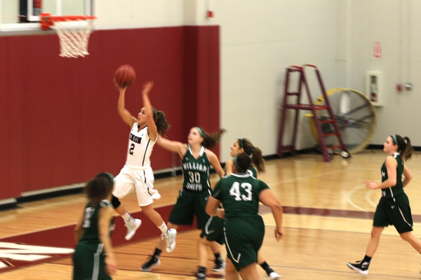 Union's Amy Fisher drives in for a lay-up.