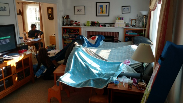 A particularly large blanket fort in the living room.
