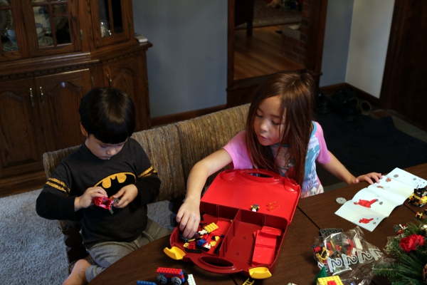 SteelyKid helping the Pip make his Lego firefighter set.