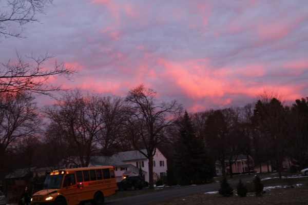 Clouds at sunrise, with the bus picking up the kid across the street.