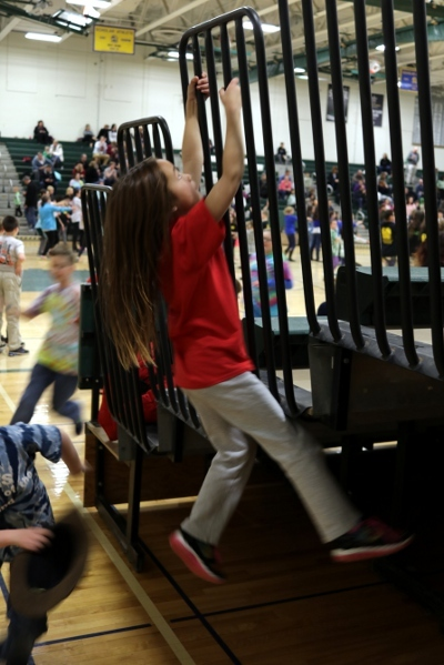 SteelyKid climbing the railing at the Odyssey of the Mind party.