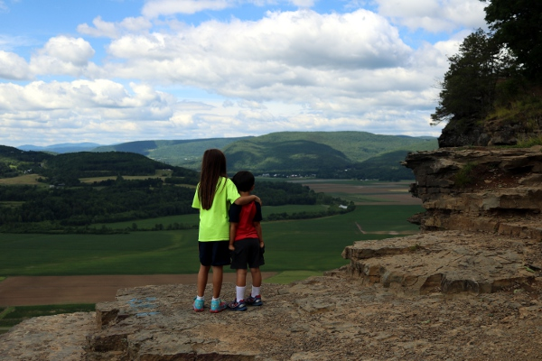 SteelyKid and The Pip looking over Scoharie County from arop Vroman's Nose.