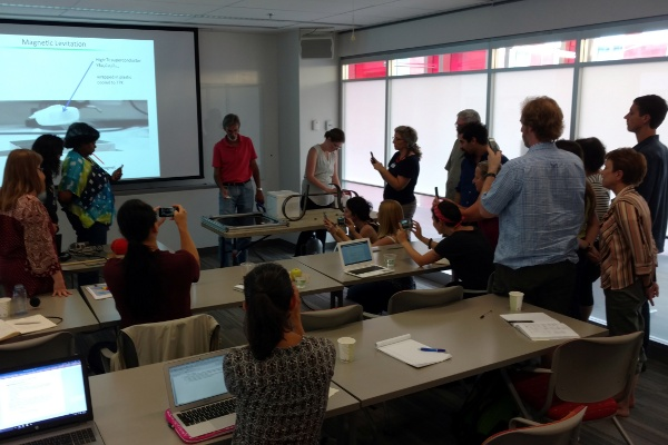 Steve Rolston and Emily Edwards of JQI doing demos at the Schrodinger Sessions workshop.