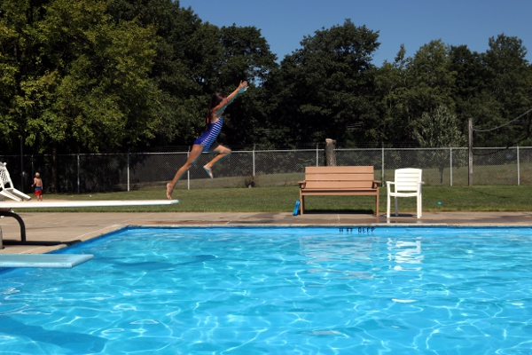 SteelyKid going off the diving board at the Niskayuna town pool.