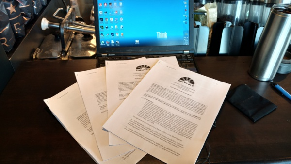 The traditional photo of a pile of signed contracts for a new book, just before mailing them.