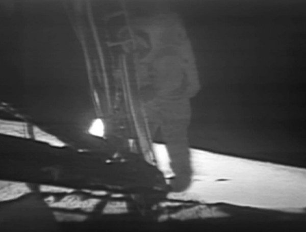 Armstrong descending to take the first steps on the Moon