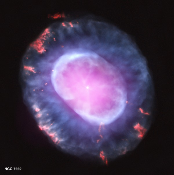 A planetary nebula represents a phase of stellar evolution that the Sun should experience several billion years from now. When a star like the Sun uses up all of the hydrogen in its core, it expands into a red giant, with a radius that increases by tens to hundreds of times. In this phase, a star sheds most of its outer layers, eventually leaving behind a hot core that will soon contract to form a dense white dwarf star. A fast wind emanating from the hot core rams into the ejected atmosphere, pushes it outward, and creates the graceful, shell-like filamentary structures seen with optical telescopes. It also looks like an exploding brain. Image credit: NASA / CXC.