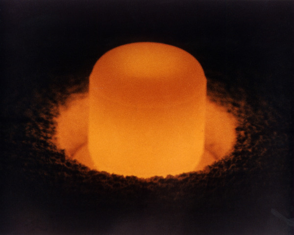 Image credit: Plutonium-238 oxide pellet glowing from its own heat; U.S. Department of Energy.