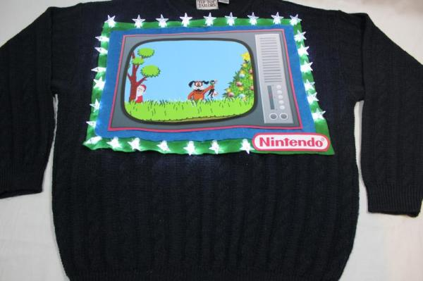 Image credit: via http://www.christmassweaters.ca/feature-xmas-sweaters/duck-hunt-christmas-sweater/.