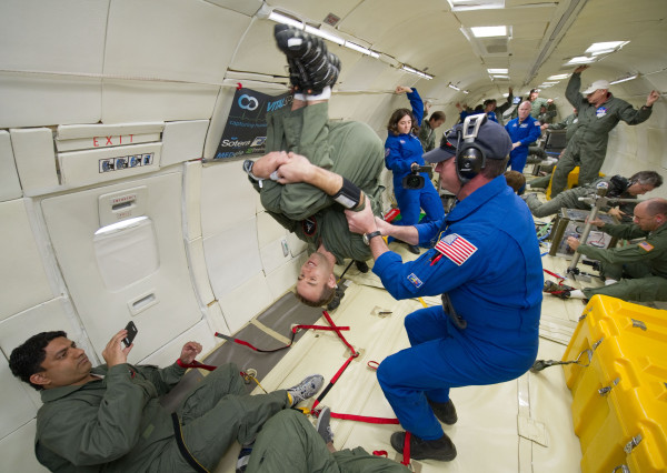 Image credit: NASA, of the Zero-gravity flight experiment testing biometric monitoring system.