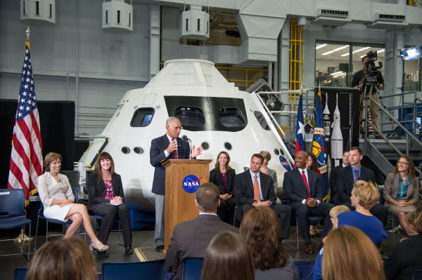 Image credit: NASA; Photographer: Robert Markowitz. NASA Administrator Charlie Bolden, at lectern in the middle of the frame, speaks at a special media-day program at the Johnson Space Center's Space Vehicle Mock-up Facility on Aug. 20, during which the 2013 class of astronaut candidates was introduced.