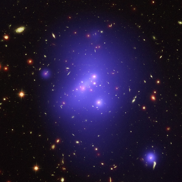 This optical/X-ray/infrared composite of the galaxy cluster IDCS J1426.5+3508 reveals the most massive cluster ever found at such a high redshift. Image composite credit: X-ray: NASA/CXC/Univ of Missouri/M.Brodwin et al; Optical: NASA/STScI; Infrared: JPL/CalTech.
