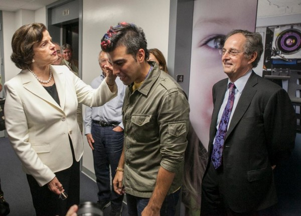 "Dianne Feinstein and Bobak Ferdowsi (a.k.a. ""NASA mohawk guy""), the activity lead for NASA's Curiosity mission. Image credit: AP Photo/Damian Dovarganes."