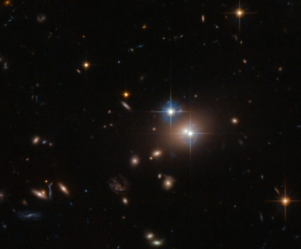 The Twin Quasar QSO 0957+561, as gravitationally lensed by the enormous elliptical galaxy, YGKOW G1, four billion light years away. This was the first gravitational lens ever discovered, in 1979. Image credit: ESA/Hubble & NASA.