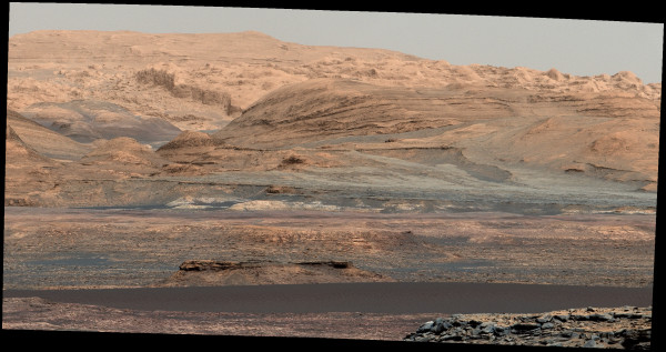 A full-color view of the rocky terrain of Mount Sharp, with the darker, lower dunes in the foreground. Image credit: NASA / JPL-Caltech / MSL Curiosity Rover.