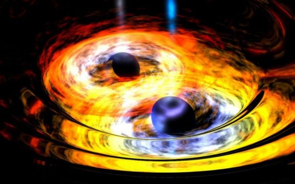 Artist's impression of two merging black holes, with accretion disks. The density and energy of the matter here is woefully insufficient to create gamma ray or X-ray bursts. Image credit: NASA / Dana Berry (Skyworks Digital).