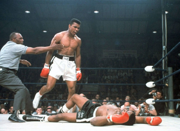 Ali taunting a fallen Sonny Liston in the first round of their second fight. Image credit: AP, via http://interactives.ap.org/2015/ali-liston-fight/.