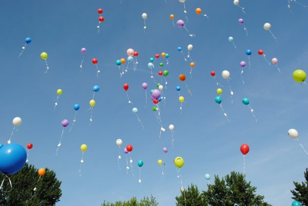 Helium balloons, where the vast majority of the helium inside will escape the Earth. Image credit: public domain photo from Pixabay user HilkeFromm.