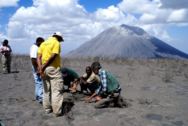 Scientists studying the ash from a recent eruption of Ol Doinyo Lengai volcano in Tanzania. Public domain photo.