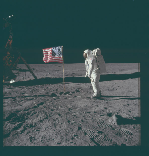 Buzz Aldrin having just planted the first American flag on the surface of a world other than our own. Image credit: NASA/Apollo 11.