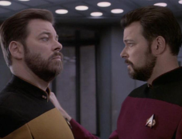 Tom and Will Riker, together on the Enterprise after the former's rescue. Image credit: Memory Alpha Wiki, by user ThomasHL, from the TNG episode Second Chances.