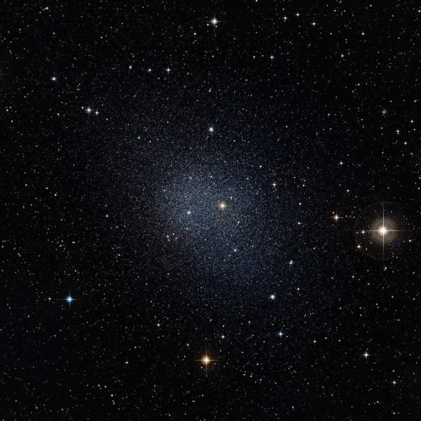 Dwarf galaxies, like the one imaged here, have a much greater than 5-to-1 dark matter to normal matter ratio, as bursts of star formation have expelled much of the normal matter. Image credit: ESO / Digitized Sky Survey 2.