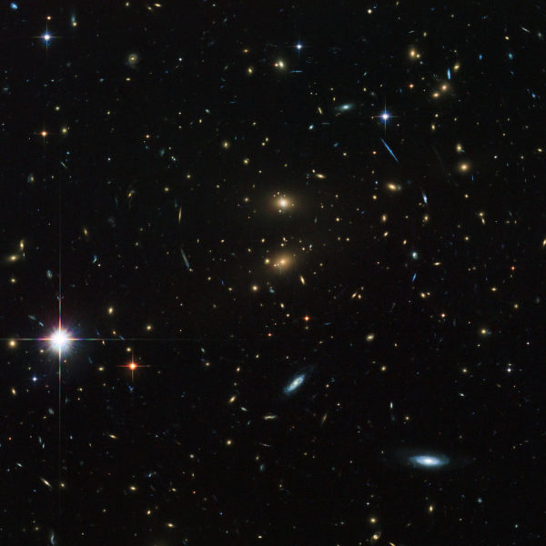 Galaxy cluster LCDCS-0829, as observed by the Hubble Space Telescope. This galaxy cluster is speeding away from us, and in only a few billion years will become unreachable, even at the speed of light. Image credit: ESA/Hubble & NASA.