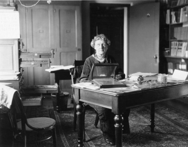 Annie Jump Cannon sitting at her desk at Harvard College Observatory, sometime in the early 20th century. Image credit: Smithsonian Institution from the United States.