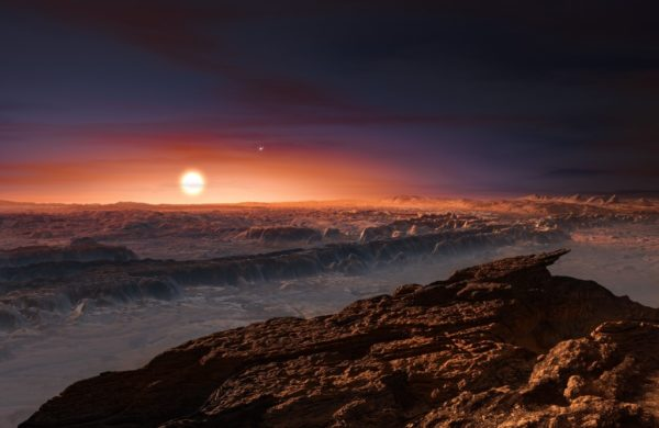 "An artist's rendition of Proxima Centauri as seen from the ""ring"" portion of the world, Proxima b. Winds would appear to originate from the direction of the Sun, always, which would never rise or set. Alpha Centauri A and B (shown) would be visible during the day. Image credit: ESO/M. Kornmesser."