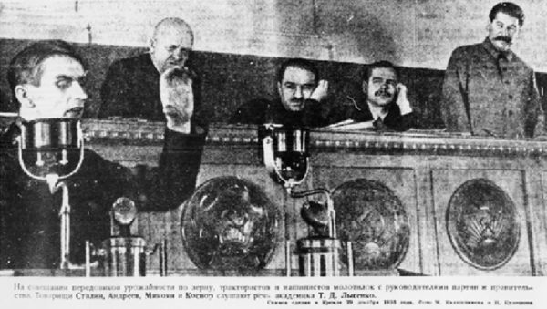 Trofim Lysenko (L), speaking at the Kremlin with Joseph Stalin (R) looking on in 1935.