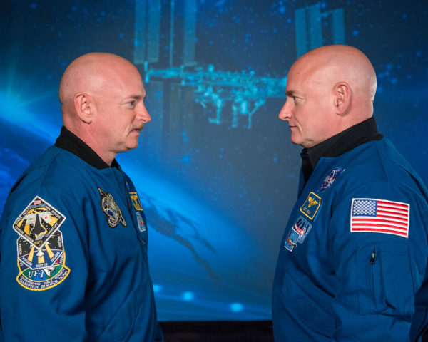 Mark and Scott Kelly at the Johnson Space Center, Houston Texas; one spent a year in space (and aged slightly less) while the other remained on the ground. Image credit: NASA.