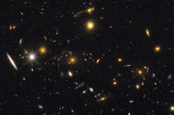 Cosmic rarities, like merging galaxies (top) and gravitational lensing phenomena (middle) can be seen at various points in the image. Image credit: NASA, ESA, R. Windhorst, S. Cohen, M. Mechtley, and M. Rutkowski (Arizona State University, Tempe), R. O'Connell (University of Virginia), P. McCarthy (Carnegie Observatories), N. Hathi (University of California, Riverside), R. Ryan (University of California, Davis), H. Yan (Ohio State University), and A. Koekemoer (Space Telescope Science Institute).