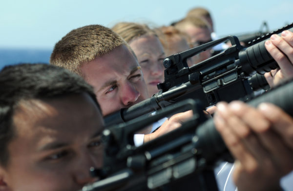 Naval soldiers prepare to fire a gun salute during a burial at sea. This would be catastrophically unsafe in any region where the bullets could come down and land on a human. Image credit: U.S. Navy photo by Mass Communication Specialist 3rd Class Kevin J. Steinberg.