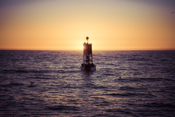 When you're at the optimal distance to measure the Earth's curvature, a buoy's bottom will be visible right on the horizon line. For a human at sea level, that will never be as much as six kilometers from the buoy. Image credit: mark_az of Pixabay.