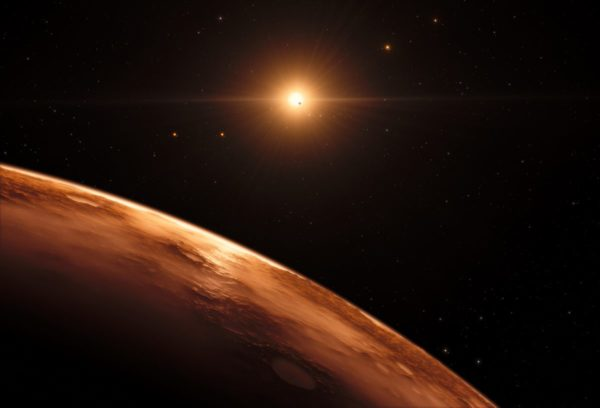 This artist's impression shows the view just above the surface of one of the planets in the TRAPPIST-1 system, which may contain liquid water on the surface if the atmospheric conditions are right. Image credit: ESO/M. Kornmesser/spaceengine.org.