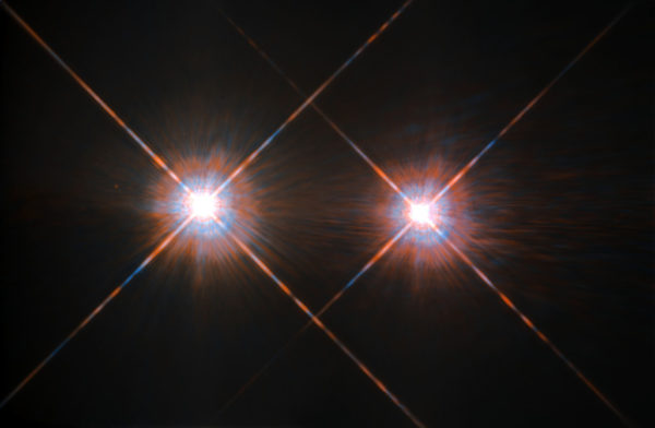The two sun-like stars, Alpha Centauri A and B, are located just 4.37 light years away from us and orbit one another at between the distances of Saturn and Neptune in our own solar system. Each may house Earth-like planets. Image credit: ESA/Hubble and NASA.