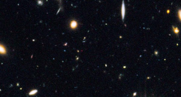 The Great Observatories Origins Deep Studies North field (GOODS-N), cropped to show the Universe's most distant galaxy, in red. All four of these circumstances needed to come together at once to make this galaxy's discovery possible. Image credit: NASA, ESA, G. Illingworth (University of California, Santa Cruz), P. Oesch (University of California, Santa Cruz; Yale University), R. Bouwens and I. Labbé (Leiden University), and the Science Team.