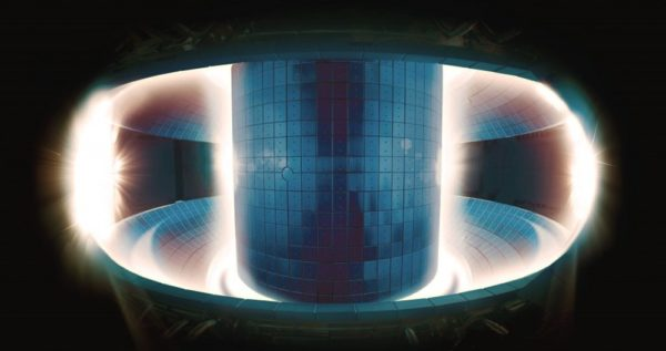 The plasma in the center of this fusion reactor is so hot it doesn't emit light; it's only the cooler plasma located at the walls that can be seen. Hints of magnetic interplay between the hot and cold plasmas can be seen. Image credit: National Fusion Research Institute, Korea.