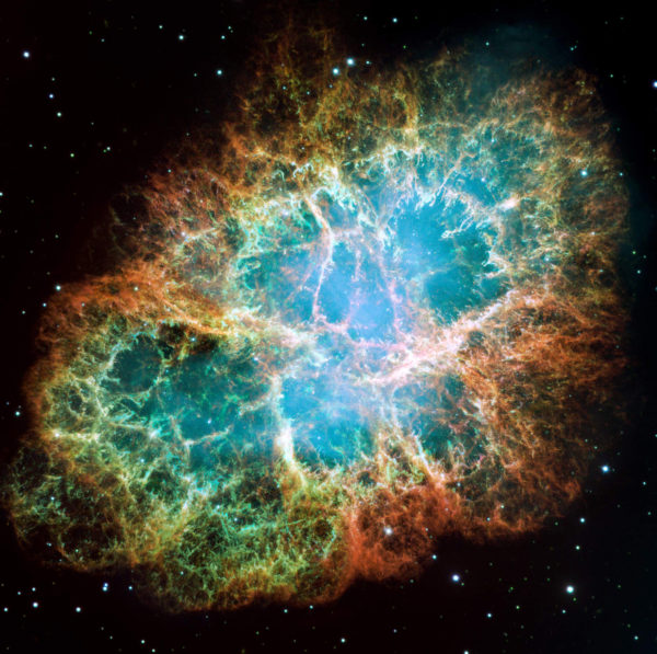 An optical composite/mosaic of the Crab Nebula as taken with the Hubble Space Telescope. The different colors correspond to different elements, and reveal the presence of hydrogen, oxygen, silicon and more, all segregated by mass. Image credit: NASA, ESA, J. Hester and A. Loll (Arizona State University).