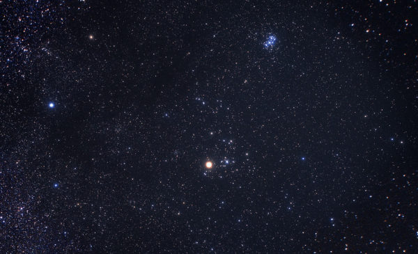 The constellation of Taurus is one of the leading candidate locations for the hypothesized Planet Nine. The bright star Aldebaran and the Hyades star cluster are the most easily identifiable objects to the naked eye in Taurus. Image credit: Akira Fujii.