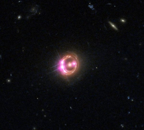 An ultra-distant quasar showing plenty of evidence for a supermassive black hole at its center. How that black hole got so massive so quickly is a topic of contentious scientific debate, but may have an answer that fits within our standard theories. Image credit: X-ray: NASA/CXC/Univ of Michigan/R.C.Reis et al; Optical: NASA/STScI.