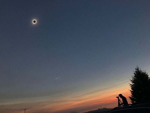 The eclipsed Sun, the visible corona, and the reddish hues around the edges of the Moon's shadow — along with human beings rapt with awe — were among the most spectacular sights of the total eclipse. Image credit: Joe Sexton / Jesse Angle.